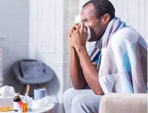 man sick with cold or flu