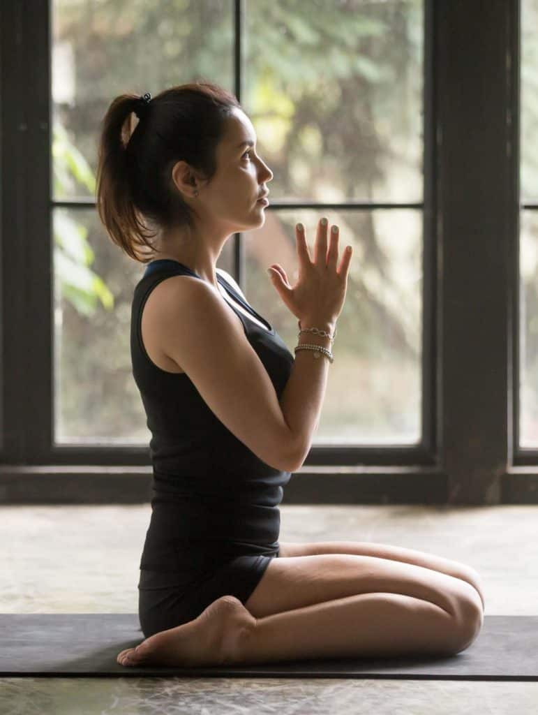 woman-in-hero-yoga-pose-Virasana