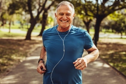 senior-man-working-out-for-good-health-listening-to-music