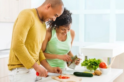 happy-healthy-couple-making-salad-in-the-kitchen