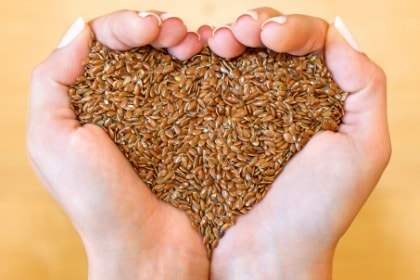 hands-holding-flax-seeds-in-heart-shape