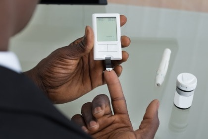 close-up-of-hands-with-glucometer-checking-blood-glucose-diabetes