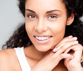 Beautiful young African-American woman smiling.