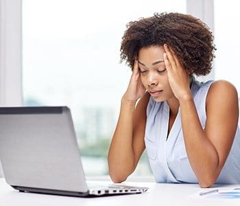 Woman stresses out while on the computer