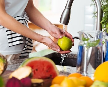 Woman Washing Fruits and Vegetables