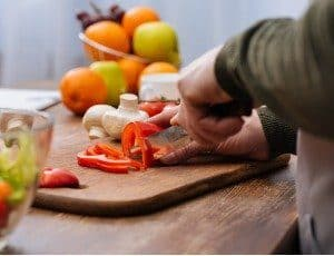 man chopping raw vegetables