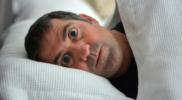 Man WIDE Awake lying in his bed