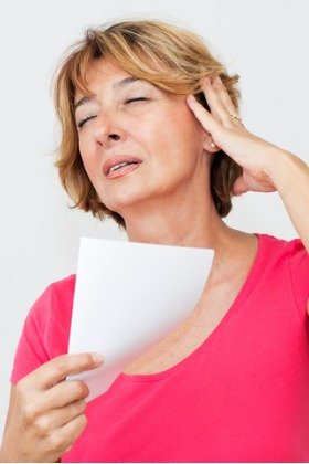 woman in menopause experiencing hot flash